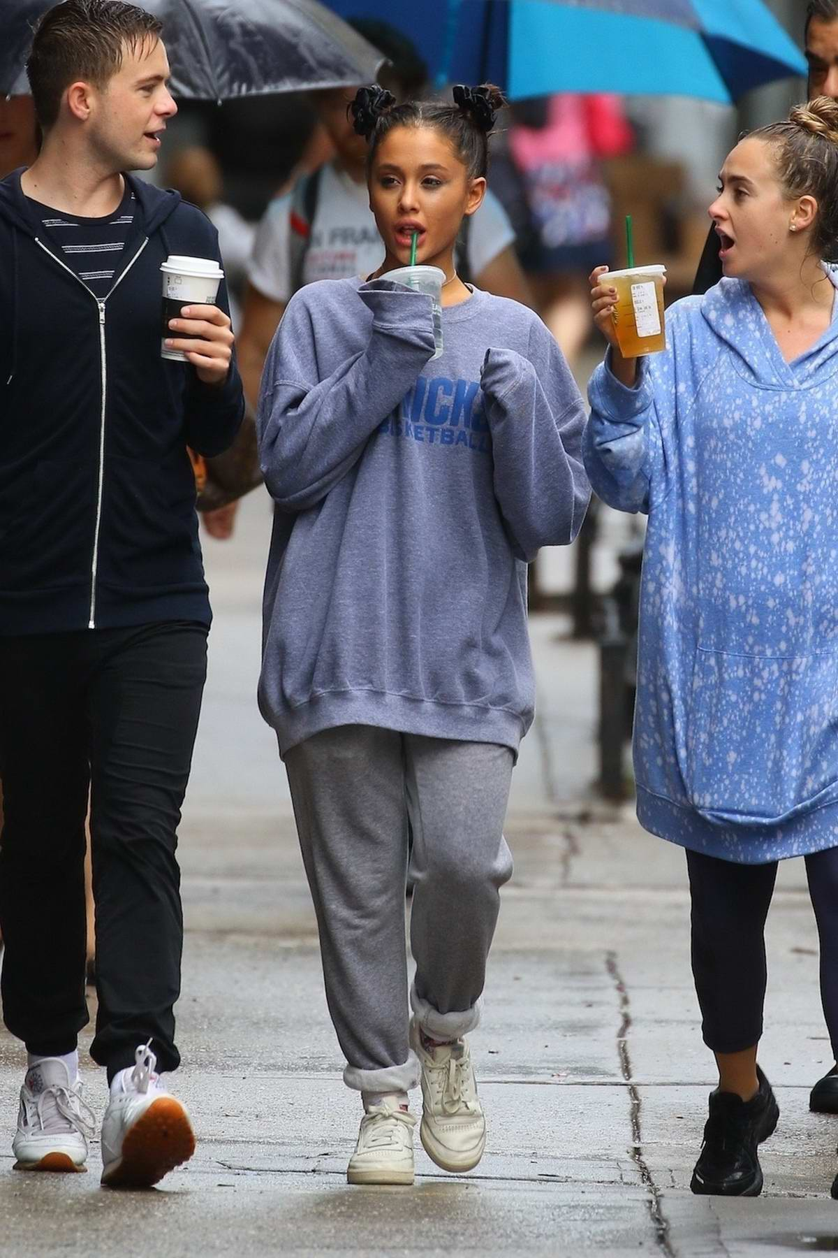Ariana Grande steps out in the rain to enjoy coffee with friends in New York City