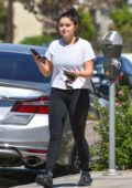 Ariel Winter seen out and about wearing a white top and black leggings in Los Angeles