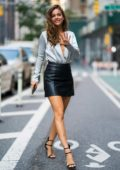 Barbara Palvin seen wearing white silk top with black leather miniskirt while visiting Victoria's Secret headquarters in New York City