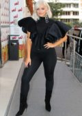 Bebe Rexha pose for the camera while out in an all black ensemble in Paris, France
