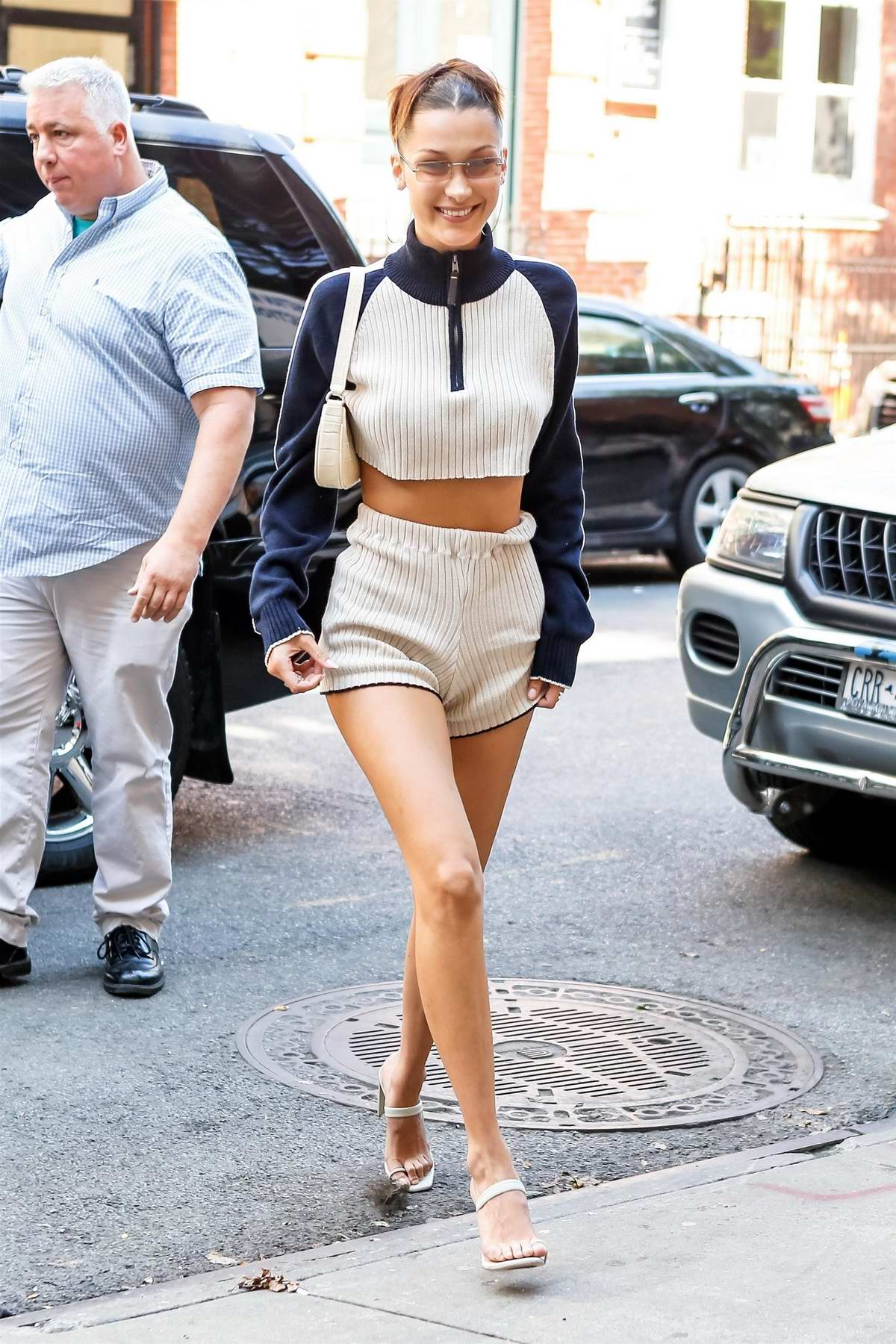 Bella Hadid is all smiles as she exits Gigi's apartment to head to a meeting in New York City