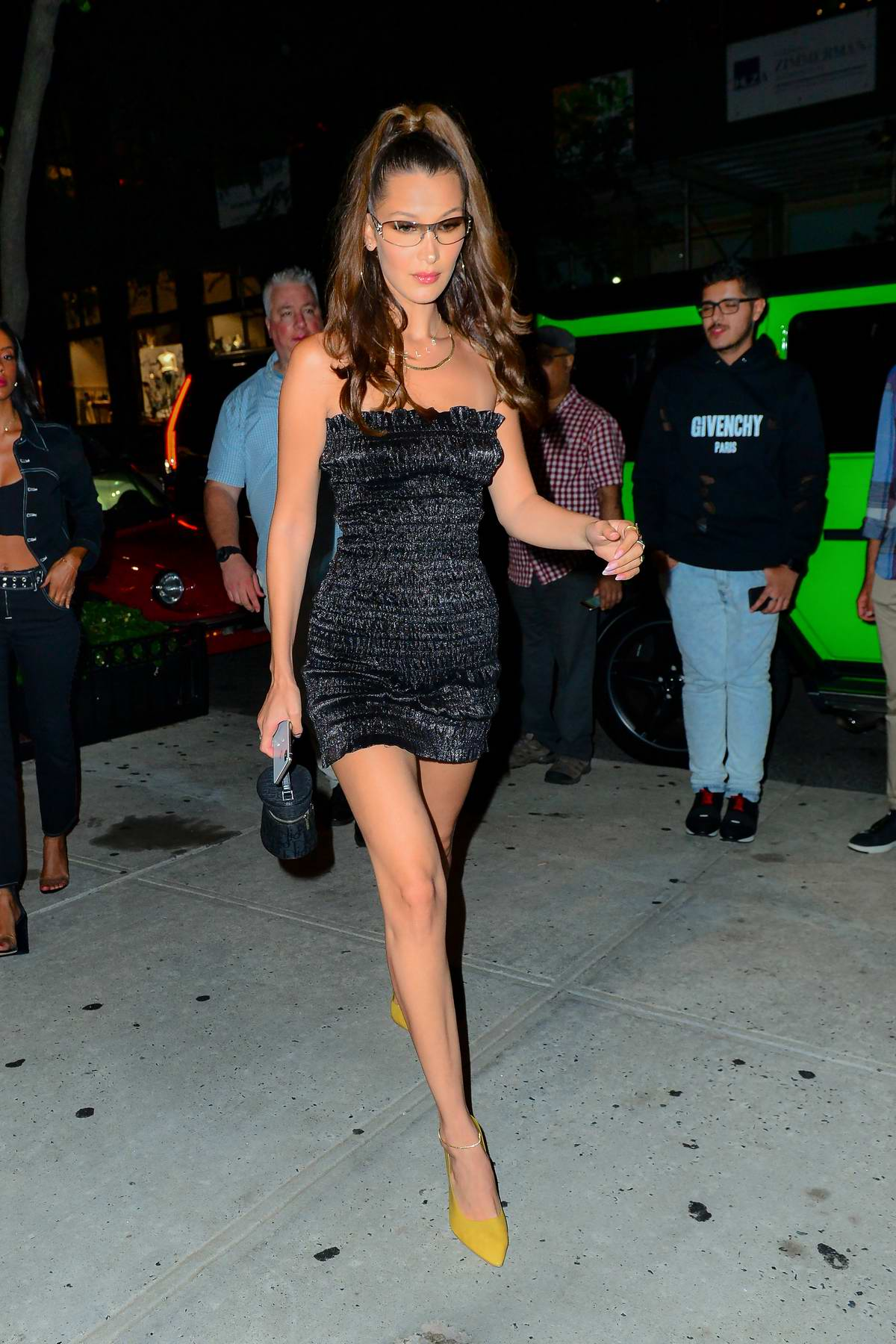 Bella Hadid wears a short black dress as she arrives at Cipriani's for a Pre-Fashion Week Party in New York City