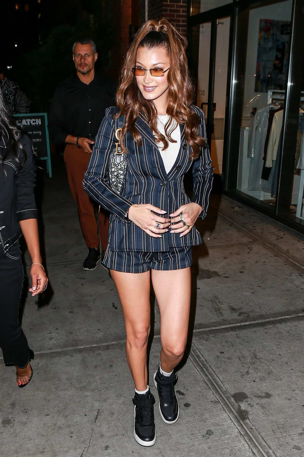 Bella Hadid wears blue pinstripe blazer with matching shorts while she hosts a meet and greet at Sephora in New York City