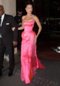 Bella Hadid wore a strapless pink gown while heading to Naked Heart Gala Dinner during Paris Fashion Week in Paris, France