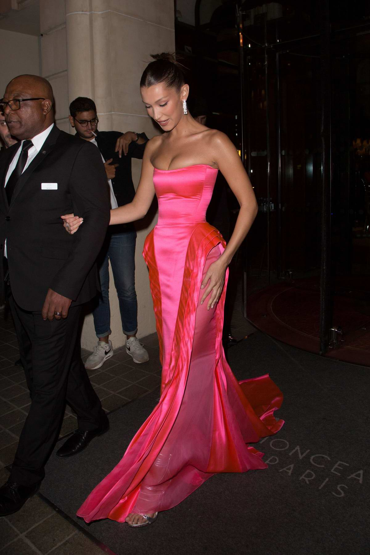 Bella Hadid wore a strapless pink gown while heading to