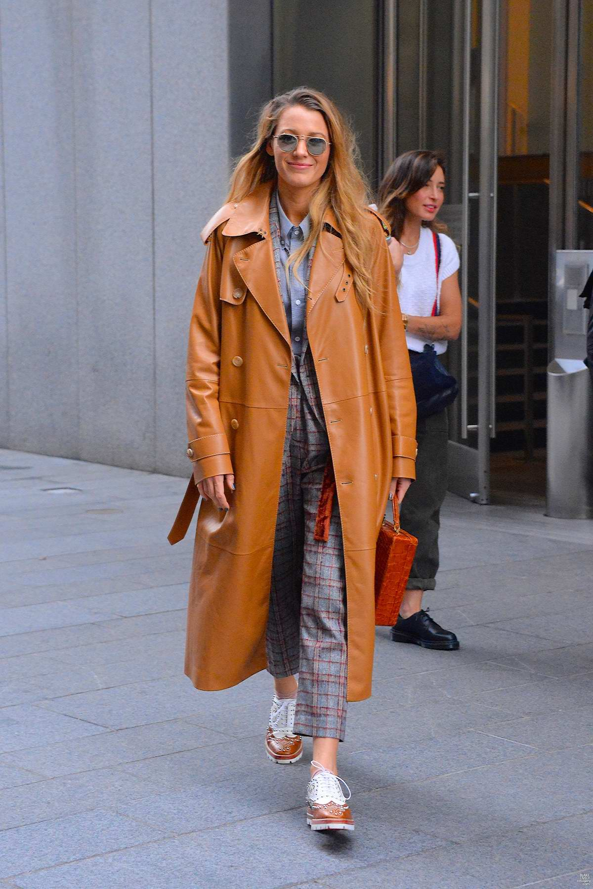 Blake Lively spotted in a brown leather overcoat as she leaves her hotel in New York City