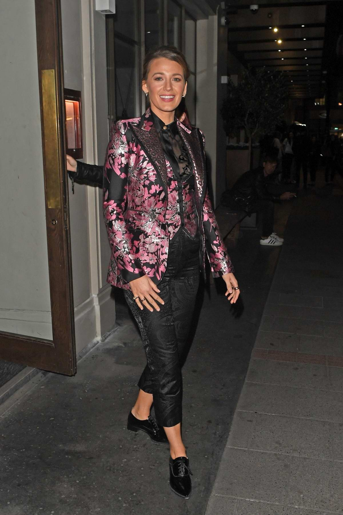 Blake Lively wore a pink and black patterned suit while out in Mayfair, London, UK