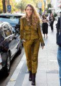 Blake Lively wore a Rag & Bone velvet pantsuit as she leaves her hotel in Paris, France
