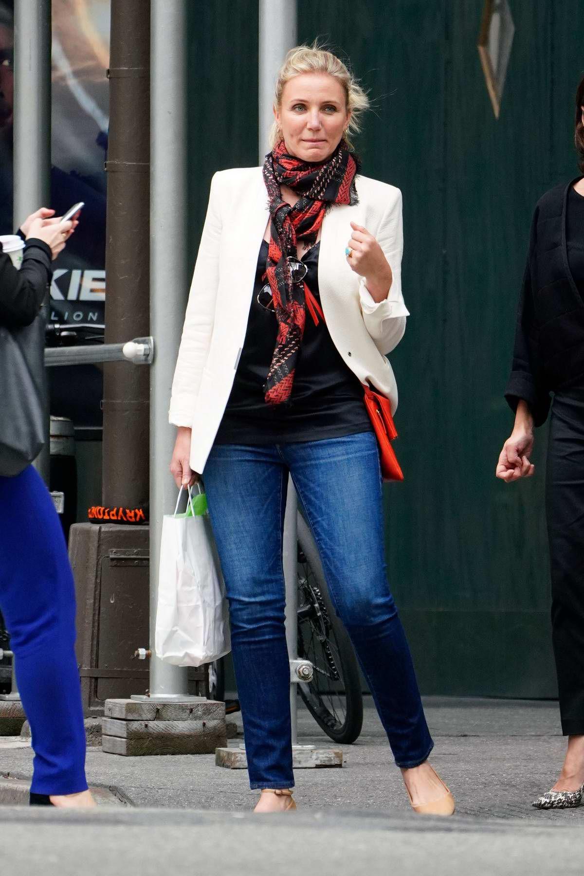 Cameron Diaz seen wearing white blazer with a scarf and jeans while out shopping with a friend in New York City