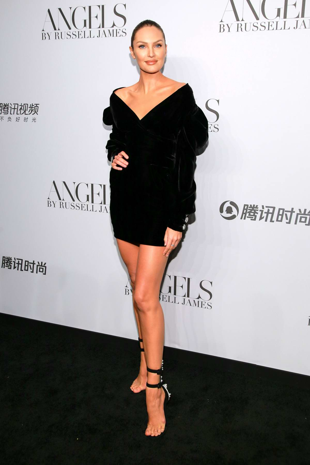 Candice Swanepoel attends 'ANGELS' by Russell James Book Launch And Exhibit in New York City