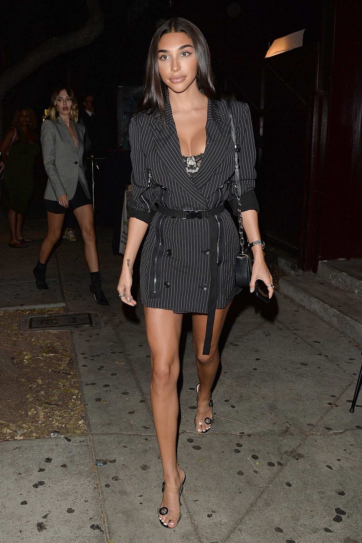 Chantel Jeffries wears a short pinstriped black dress as she heads for a night out in West Hollywood, Los Angeles
