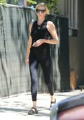 Charlize Theron steps out in a black tank top with matching leggings while running errands in Los Angeles