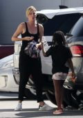 Charlize Theron steps out with her kids wearing her black leisurewear in Los Angeles