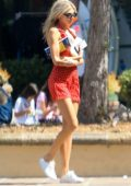 Charlotte McKinney looks cute in a red and white polka dot dress while out shopping with a friend in Malibu, California