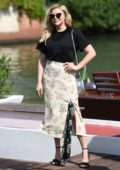 Chloe Grace Moretz spotted in a black top with a floral print skirt as she arrive at the Hotel Excelsior during 75th Venice Film Festival in Venice, Italy