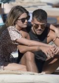Chloe Lloyd and Josh Cuthbert enjoys a relaxing day at the beach in Mykonos, Greece