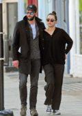 Daisy Ridley and boyfriend Tom Bateman enjoys a romantic stroll around Primrose Hill in London, UK
