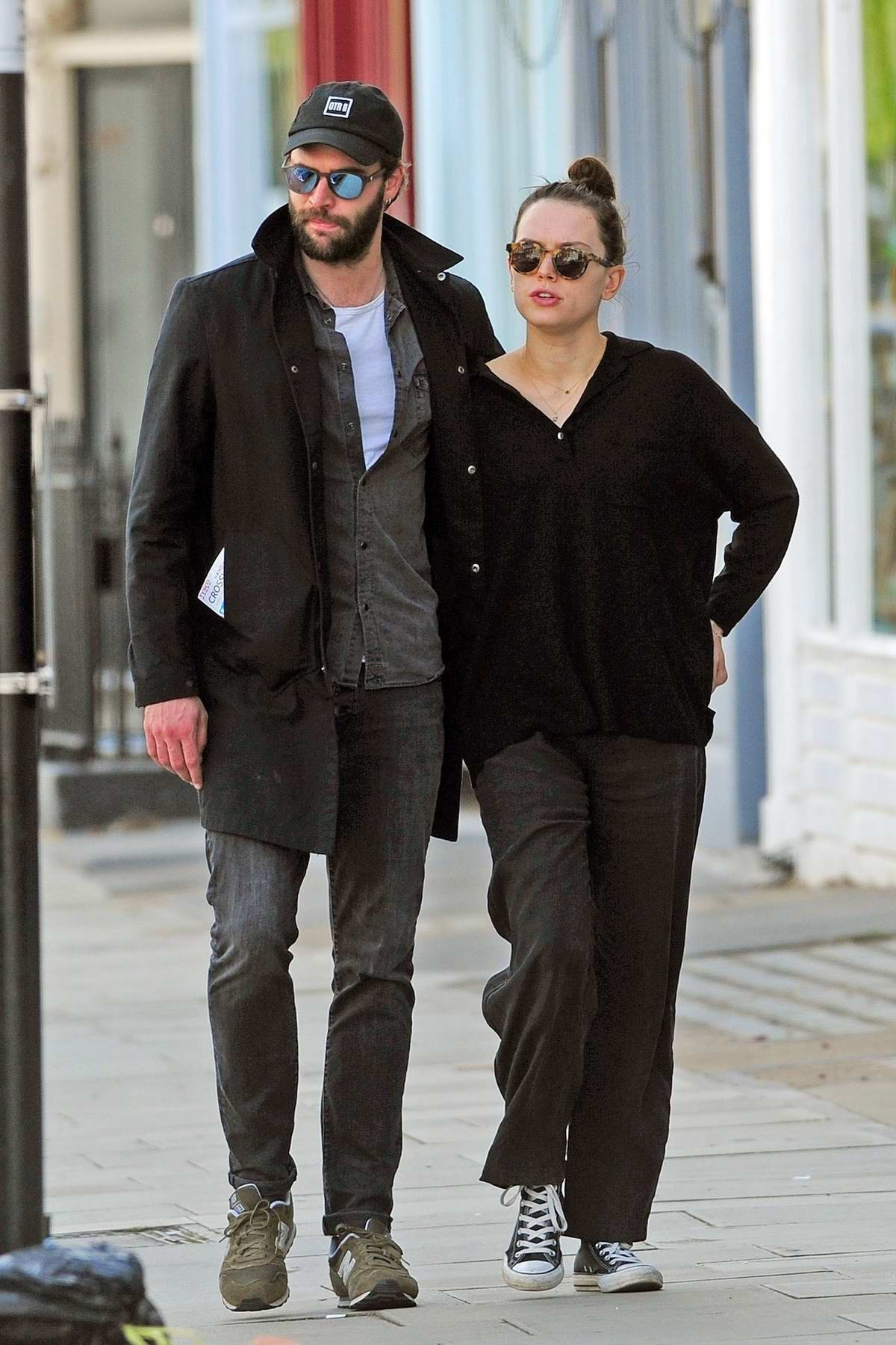 Daisy Ridley and boyfriend Tom Bateman enjoys a romantic stroll around Primrose Hill in London, UK