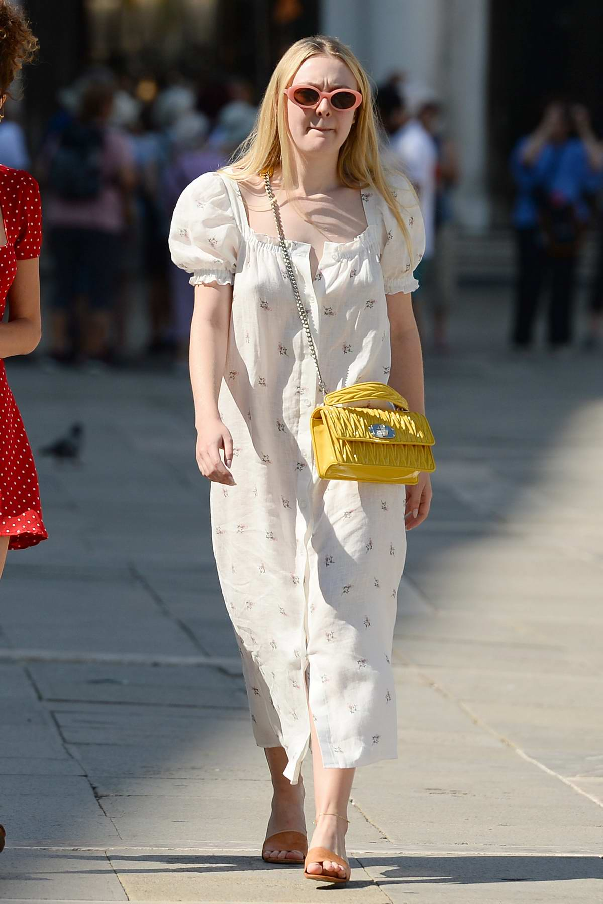 Dakota Fanning seen out with a friend while enjoying the sights and food in Venice, Italy