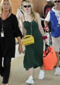 Dakota Fanning spotted at the airport in a green dress as she leaves after attending 75th Venice Film Festival, Italy