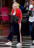 Dakota Fanning steps out for a stroll in the rain in SoHo, New York City