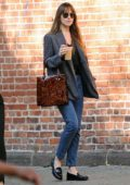 Dakota Johnson grabs an iced coffee and enjoys a day of shopping with some friends in New York City