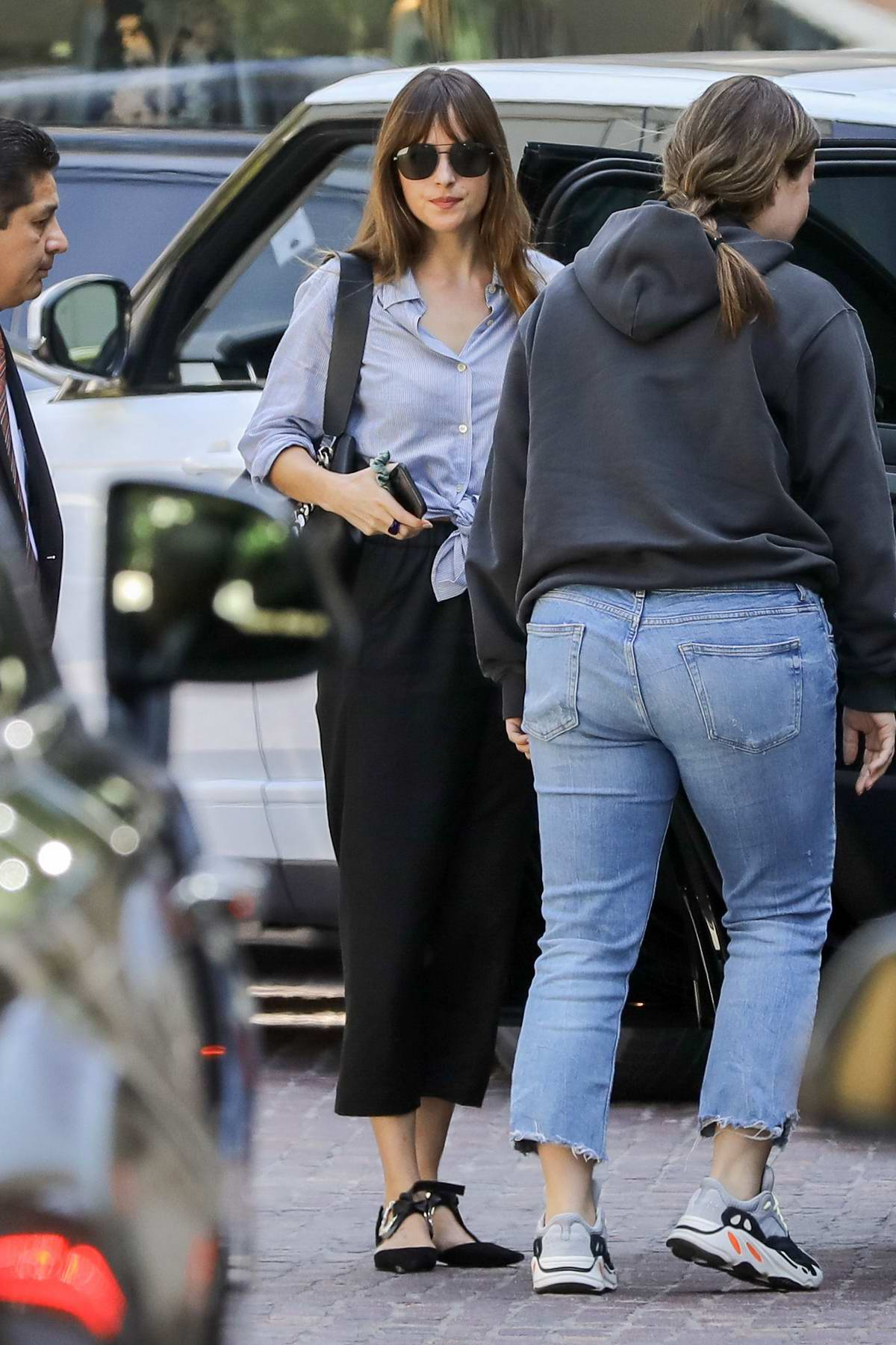 Dakota Johnson spotted while out with a friend in Beverly Hills, Los Angeles
