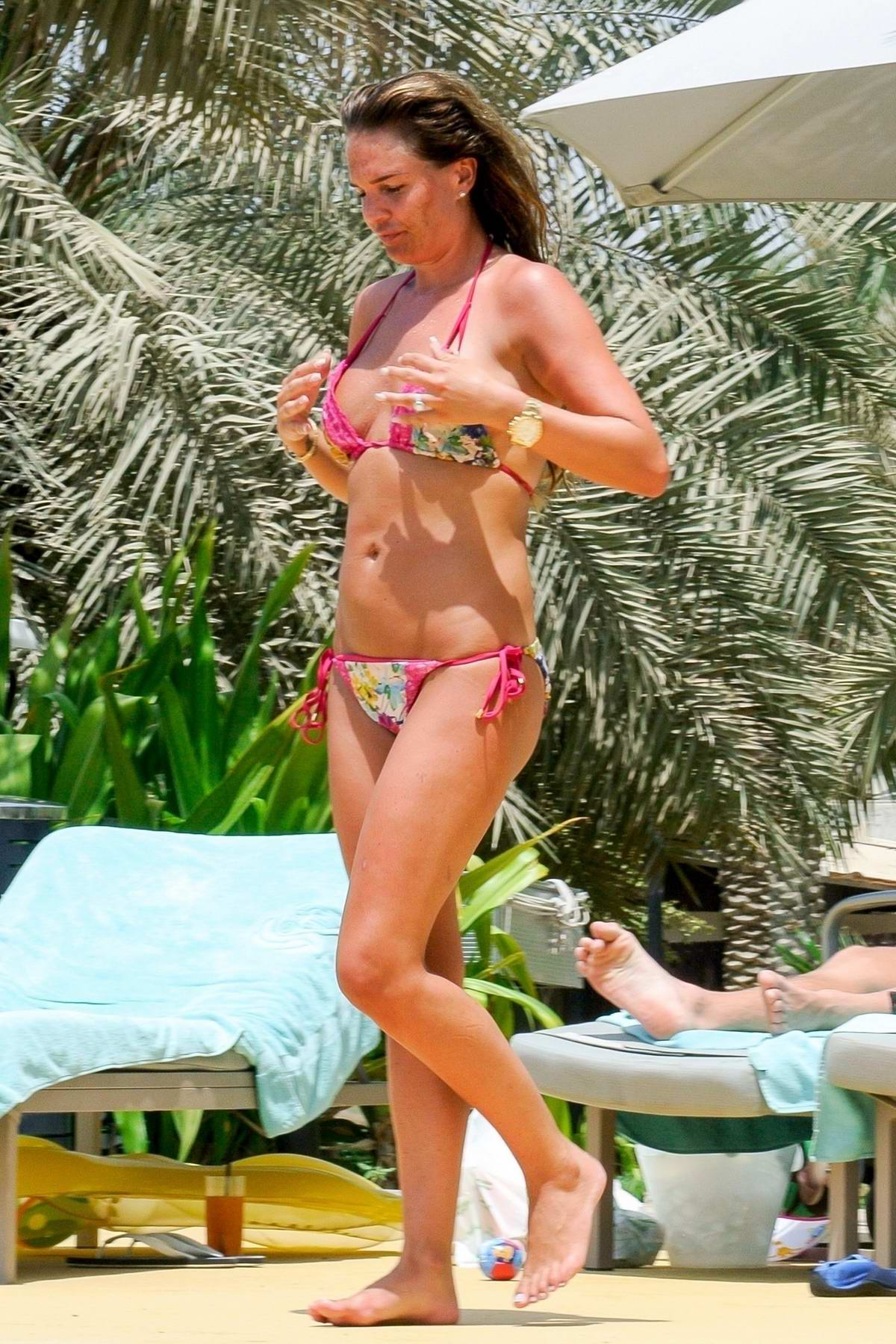 Danielle Lloyd spotted in a floral patterned bikini while relaxing by the pool in Dubai
