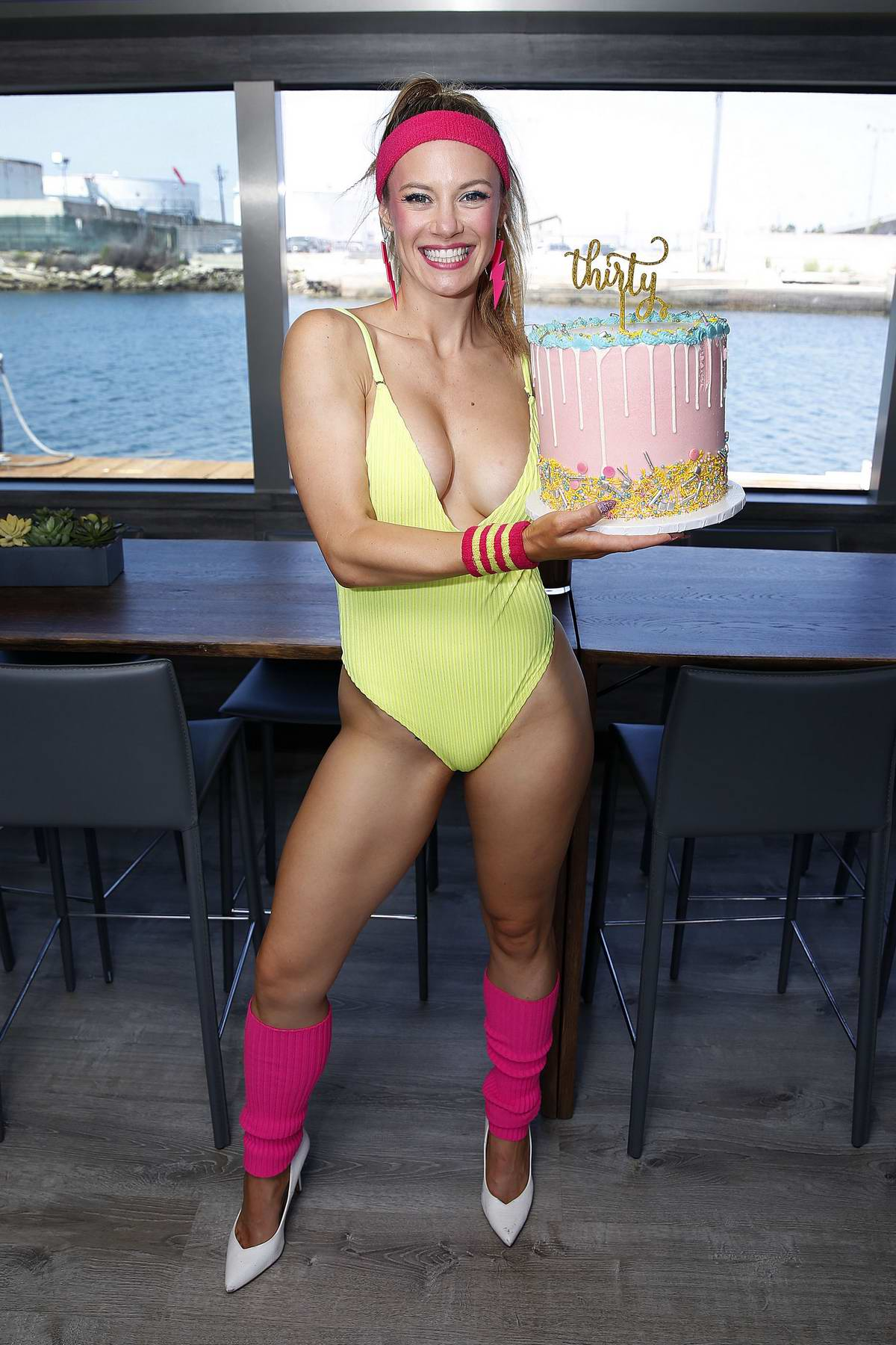 Danielle Savre wore a neon green swimsuit to celebrate her 30th birthday on a party boat with friends in Los Angeles