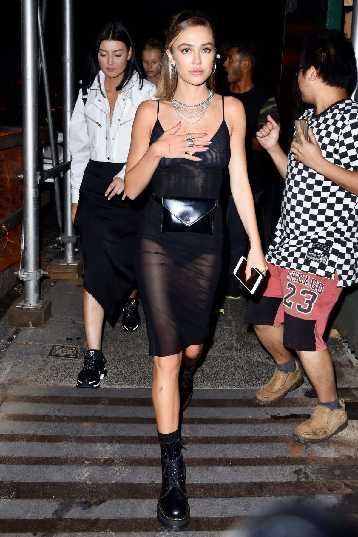 Delilah Hamlin spotted in a sheer black dress during a night out with friends in New York City