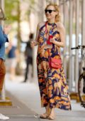 Diane Kruger shows off her baby bump while heading out in a patterned maxi dress in New York City