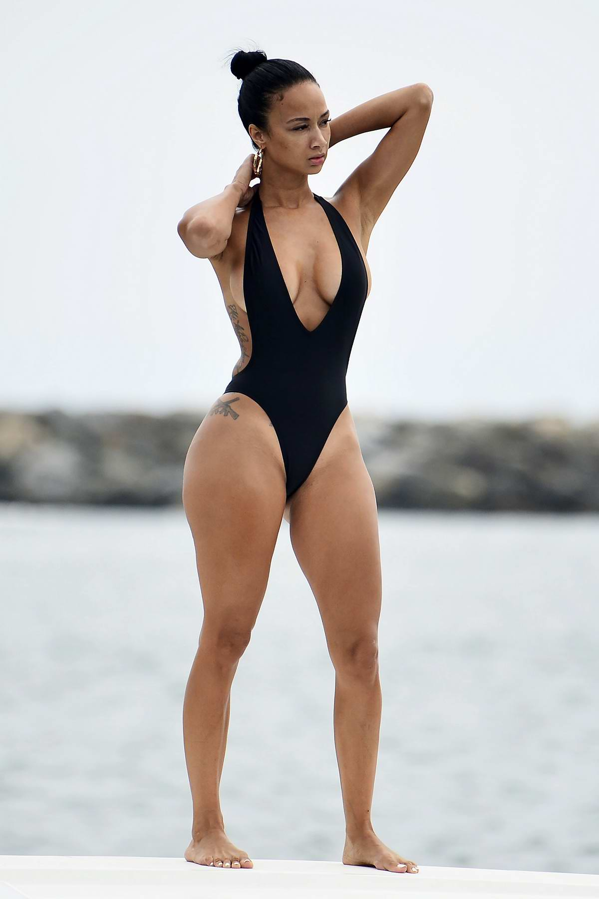 Draya Michele rocks black swimsuit from her new Mint collection while enjoying a day on a boat with her friends at Newport Beach, California