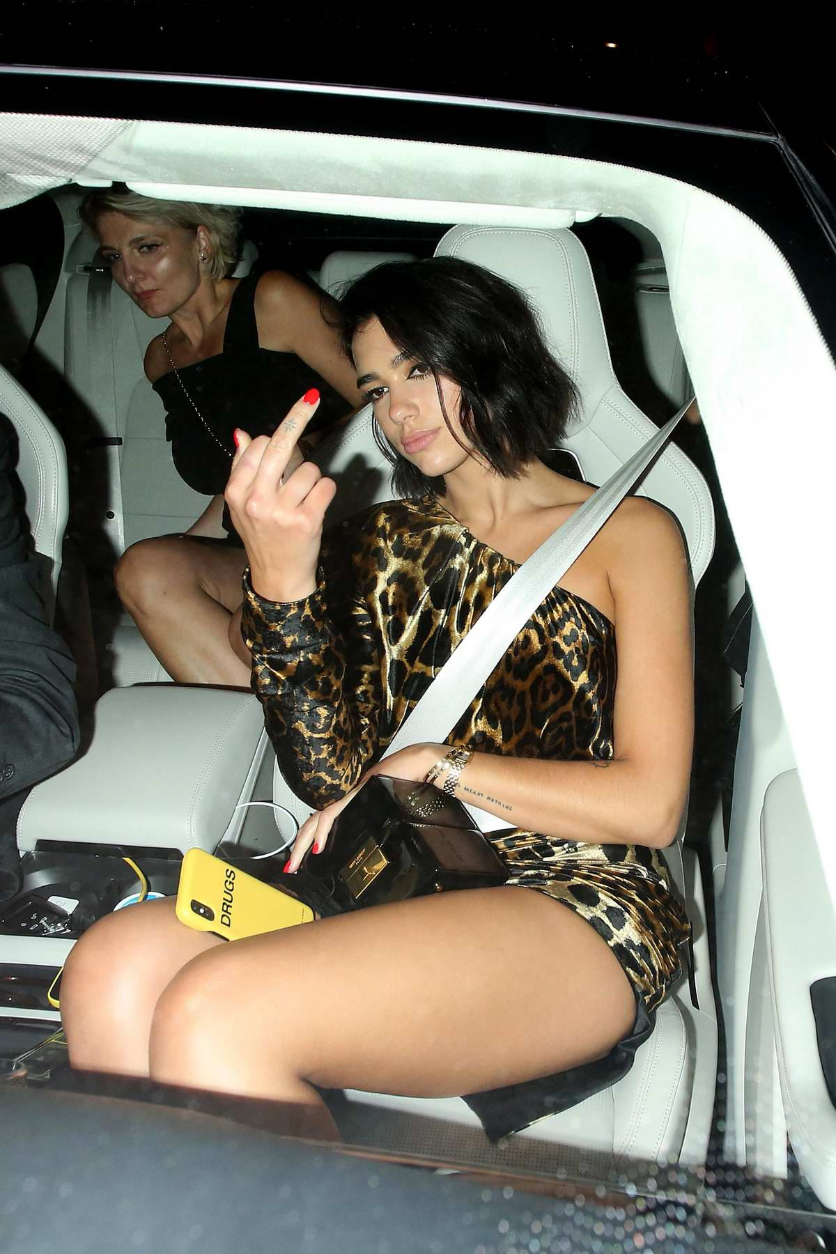 Dua Lipa seen while leaving GQ Awards after party wearing a short leopard print dress in London, UK