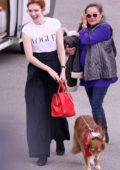 Eleanor Tomlinson seen with her dog on the set of Poldark in Charlestown, UK