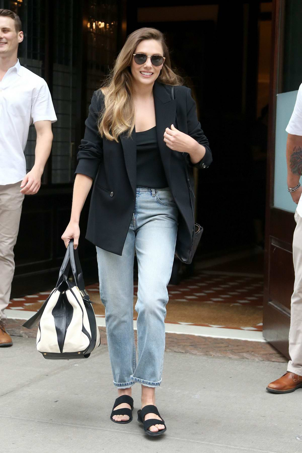Elizabeth Olsen keeps it casual in a black blazer and jeans while stepping out in New York City