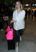 Elle Fanning touches down at Charles de Gaulle airport in Paris, France