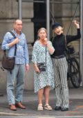 Elsa Hosk spotted in a sheer black sweater and striped pants as she takes her parents for sightseeing in New York City