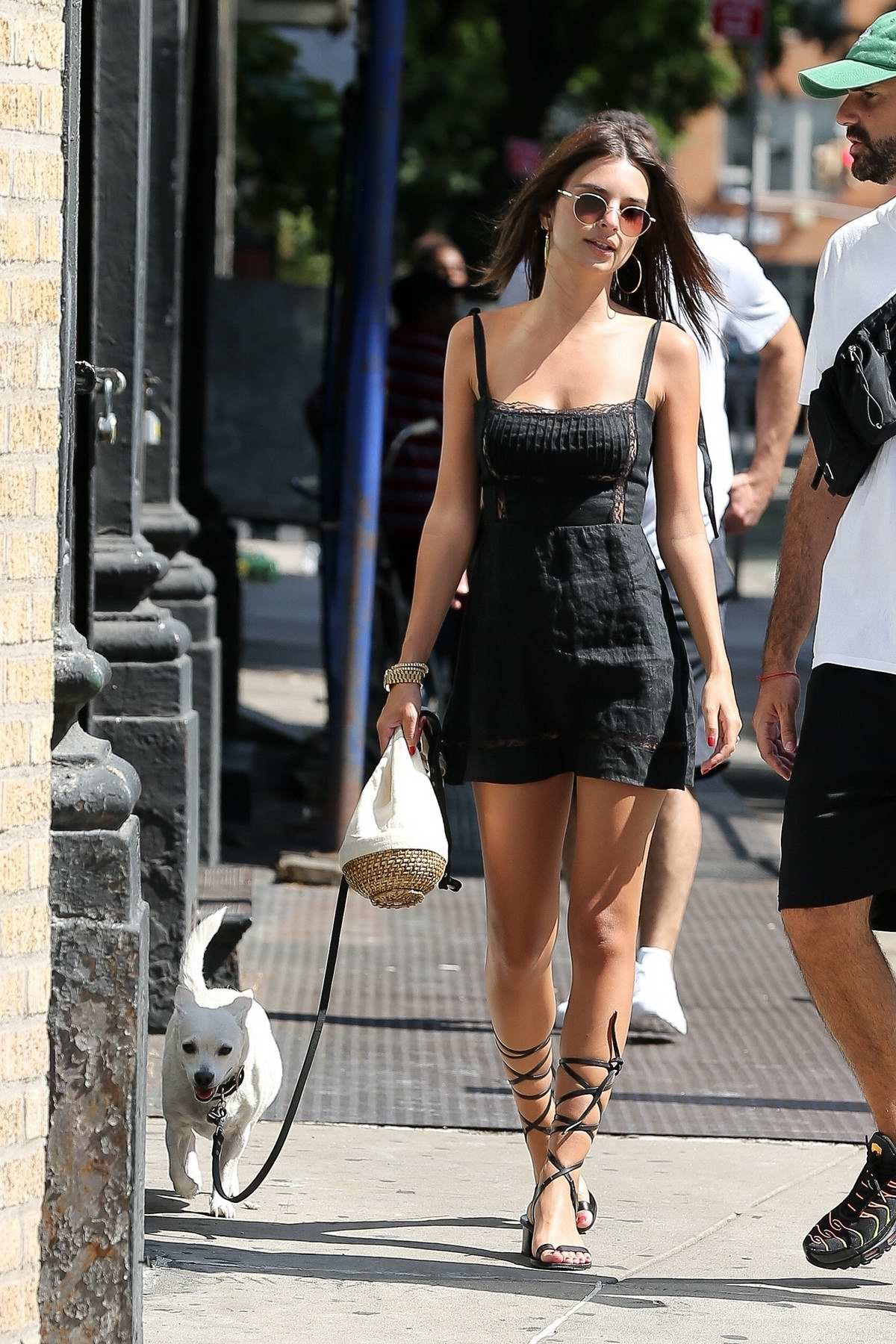 Emily Ratajkowski spotted in LBD while out for a stroll with her dog and a friend in New York City