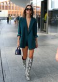 Emily Ratajkowski steps out in a turquoise blazer and shorts with knee high snakeskin boots during Milan Fashion Week in Milan, Italy
