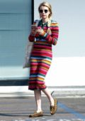 Emma Roberts steps out in a colorful stripe dress as she stops by an Urgent Care in Hollywood, Los Angeles