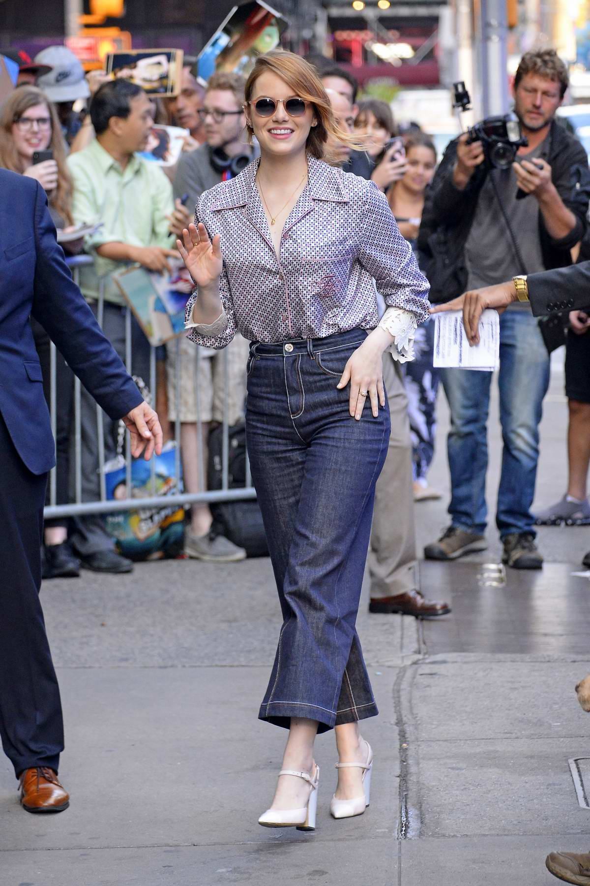 Emma Stone wore a patterned shirt and high waisted dark jeans as she arrives at Good Morning America in New York City