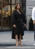 Eva Longoria steps out of her hotel in a black dress in Paris, France