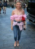 Georgia Toffolo spotted wearing a pink off-shoulder top and jeans as she arrives at Global Studios in London, UK