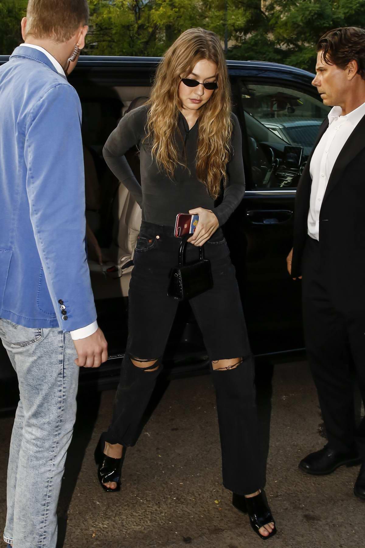 Gigi Hadid arrives to Fendi fittings during Milan Fashion Week in Milan, Italy