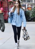 Gigi Hadid looks radiant in a denim shirt and black leggings as she steps out in New York City