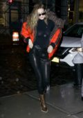 Gigi Hadid seen wearing red Fendi puffer jacket and leather pants while out in New York City