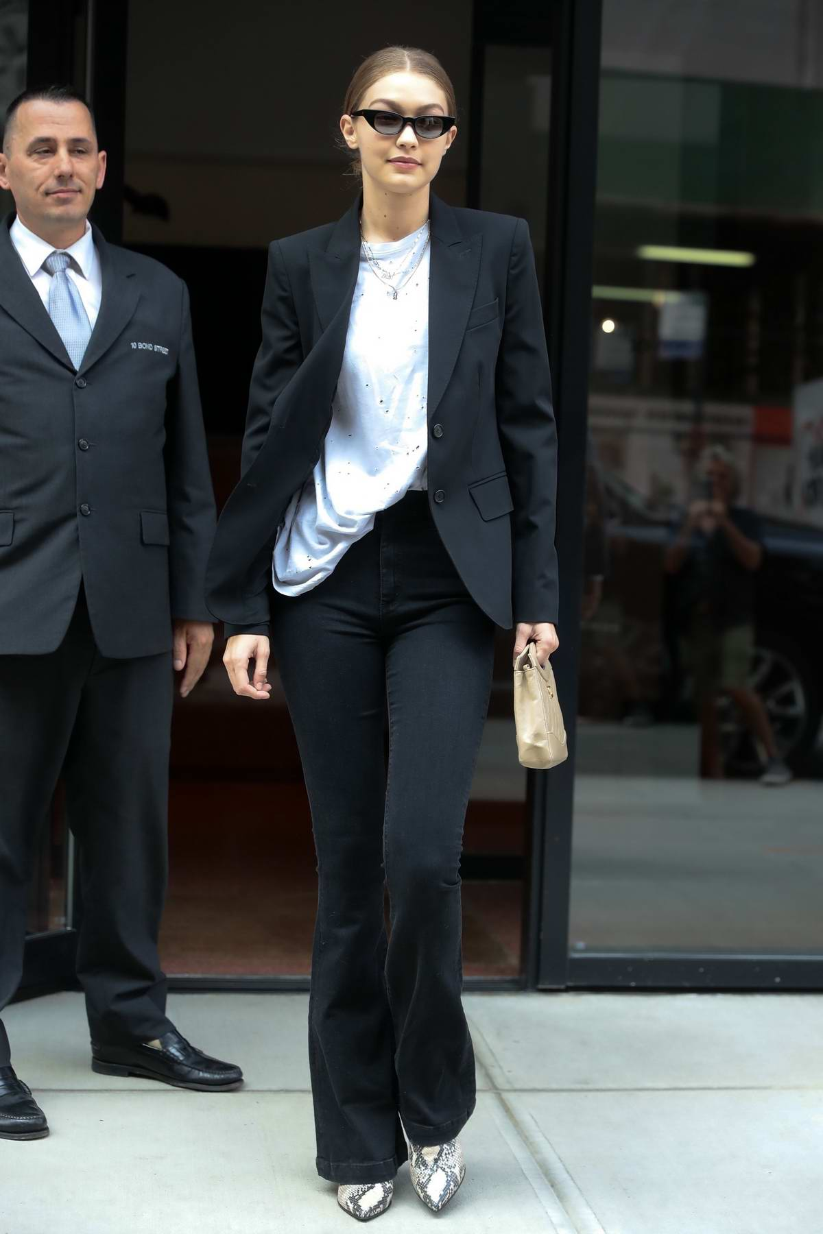 Gigi Hadid shows off a business chic look as she leaves her apartment in New York City