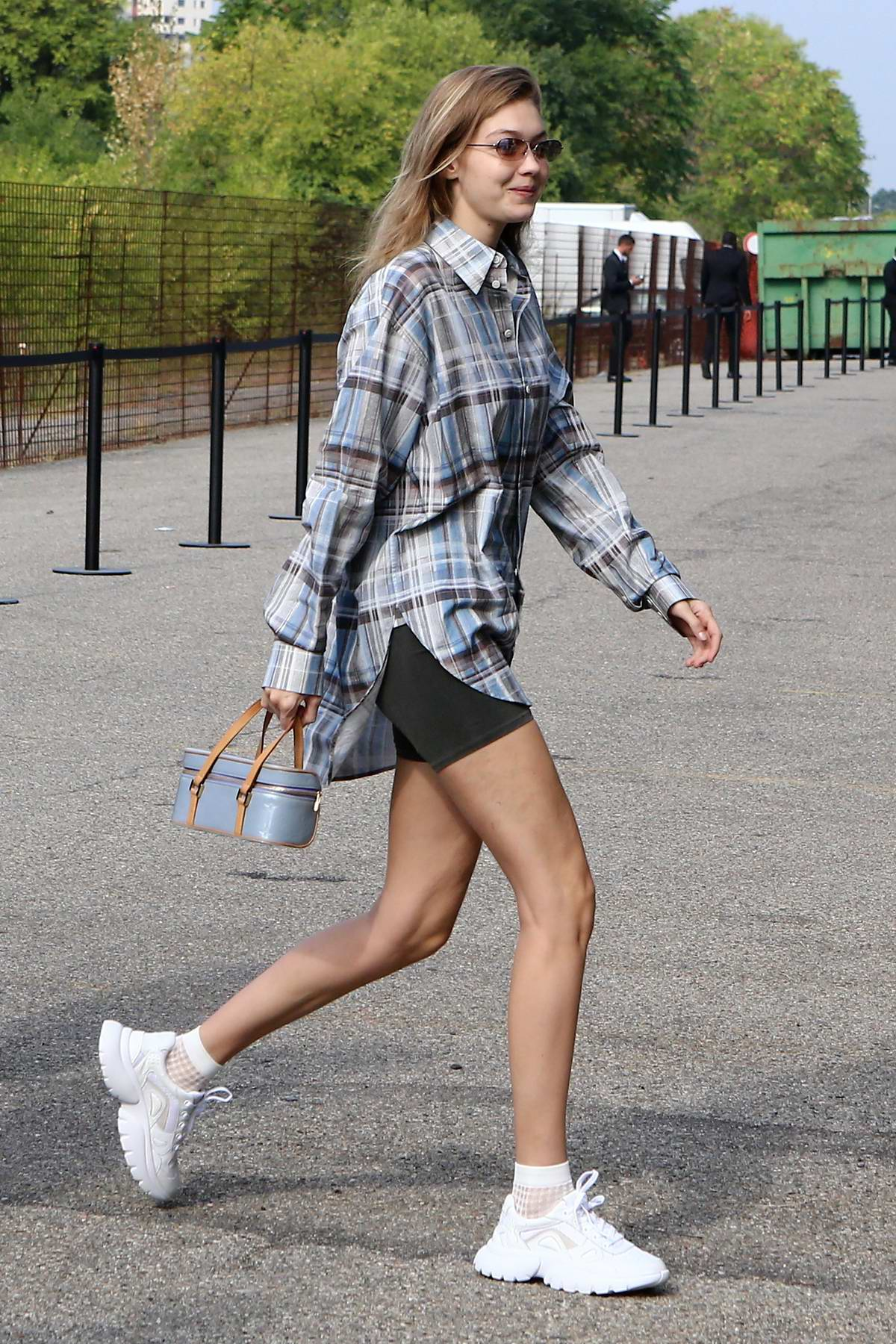 Gigi Hadid spotted in plaid shirt and bikers shorts as she arrives at the Roberto Cavalli Fashion Show During Milan Fashion Week in Milan, Italy