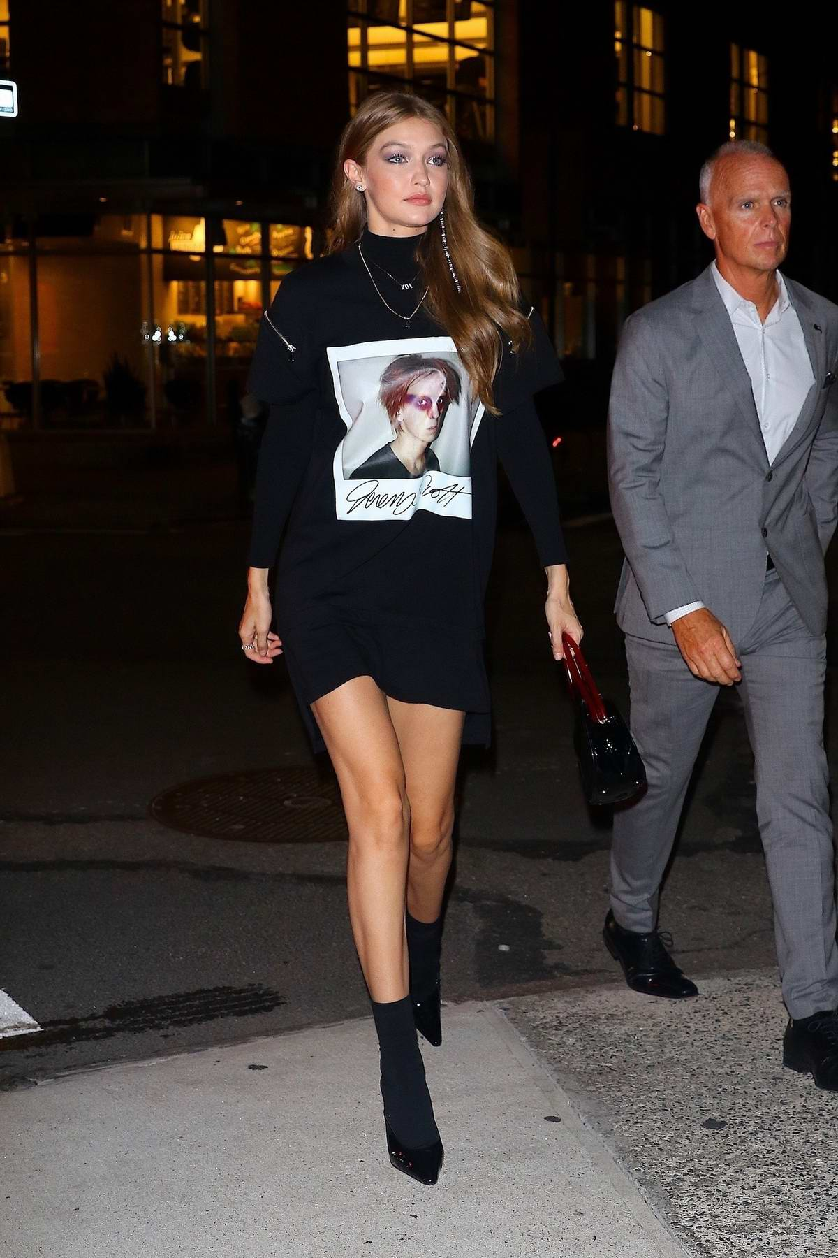 Gigi Hadid stepped out in a Jeremy Scott graphic tee as she heads out to dinner in New York City