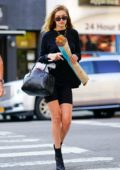 Gigi Hadid steps out in an all black ensemble while she picked up a baguette in New York City